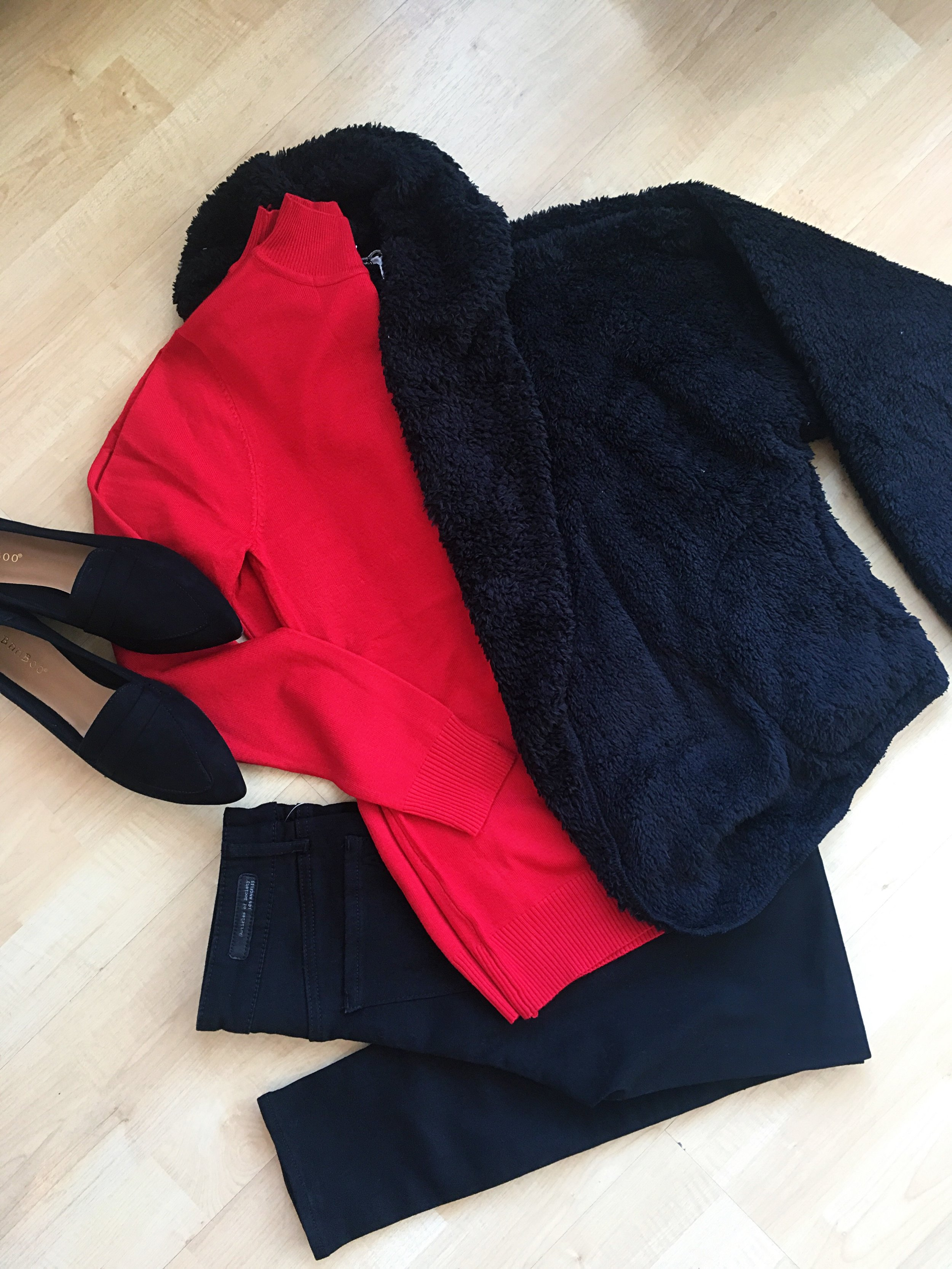 We just got these fuzzy sweater jackets in - we have them in black and gray. So soft and so cozy!
