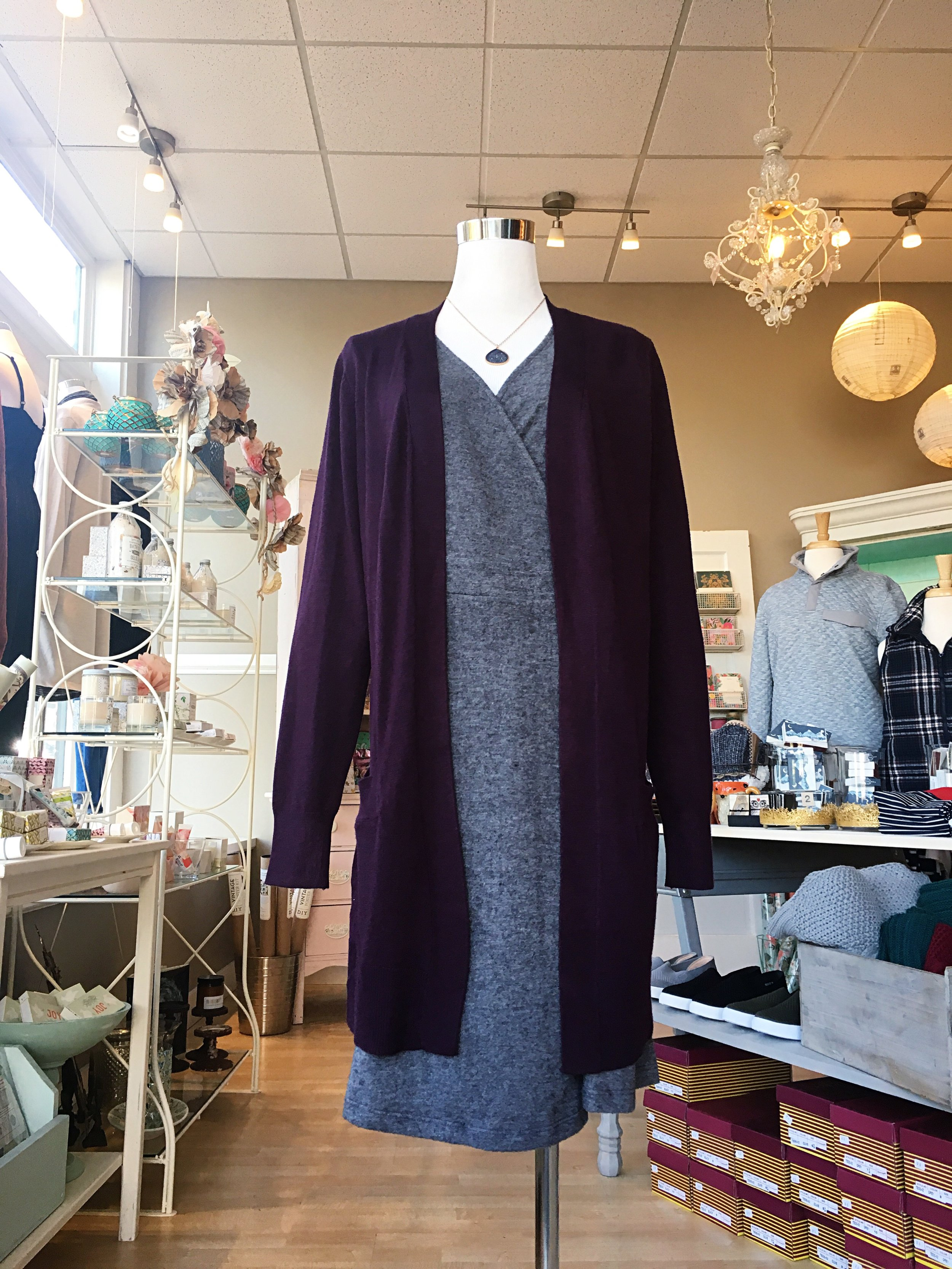 We have these long cardigans in purple, charcoal gray, light gray, navy and black. Versatile and stylish, they are perfect to layer over jeans + sweaters as well as dresses.