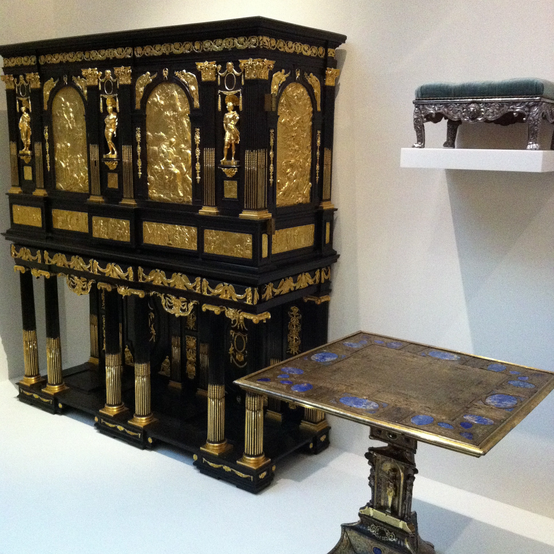 17th Century Parisian 'Marie de Medici' cabinet with ebony veneer and gilded brass plaques depicting scenes from a romantic poem