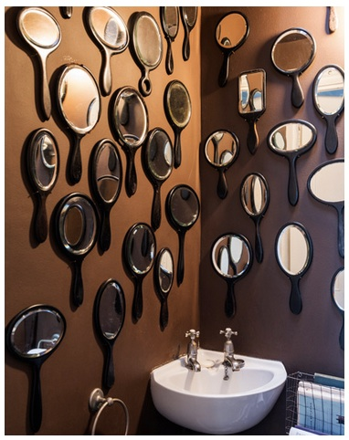 Flo's collection of ebony hand mirrors in the bathroom