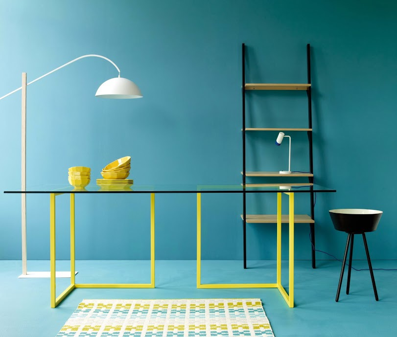 The adjustable Bip overreach light, on the left, and some skinny-legged furniture
