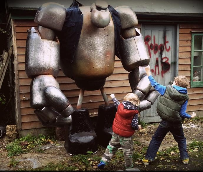 Our sons Leo and Benny squaring up to the giant robot