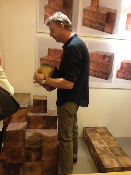 Giovanna introduced me to the designer  Paul Kelley  (above) who was showing these  amazing magnetic copper cubes  that configure any way you like and looked just like real live Minecraft blocks.