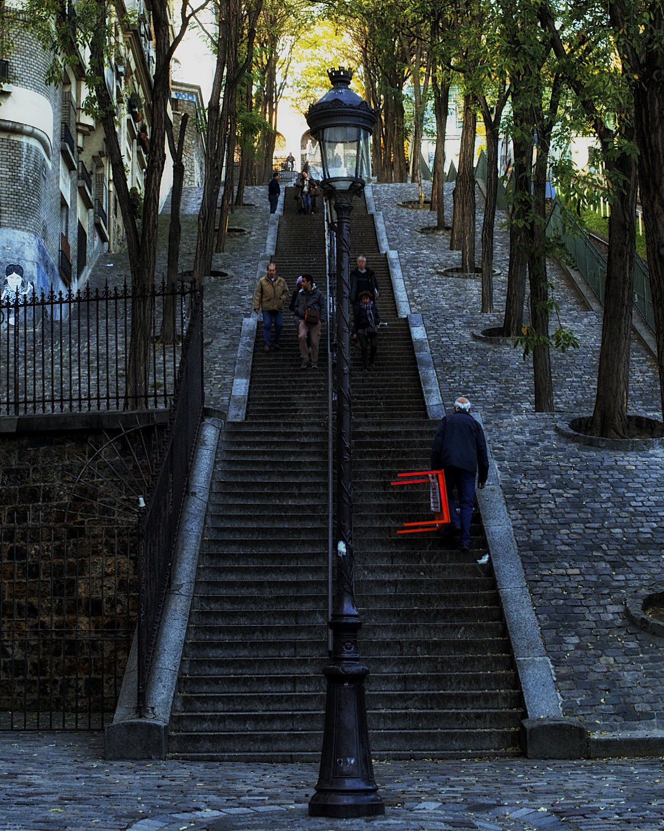 carrying a table up the steps to montmarte.jpg