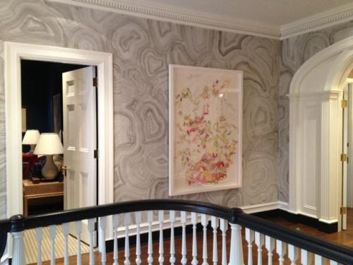 l arge collage on incredible hand painted wallpaper in upstairs foyer
