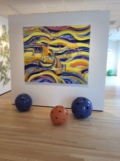 spheres and painting by selena beaudry in gallery