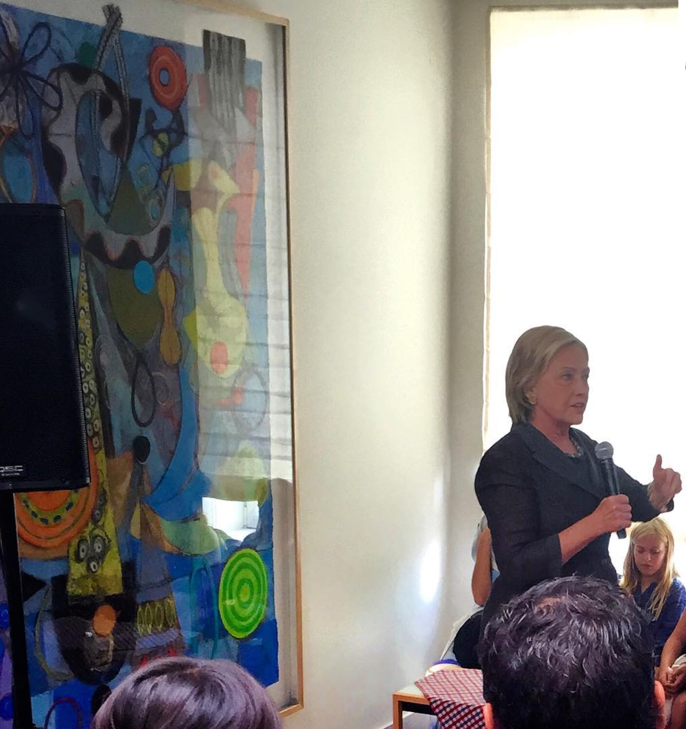 hillary clinton  speaking in nyc this past weekend at a private residence in front of gallery artist  geraldine neuwirth' s large collage.  new collages just arrived for her solo exhibition in november at the gallery.