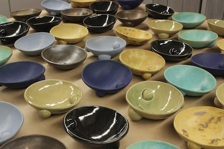 scotchie's platters follow a generally similar design but vary in terms of size, type of glaze and placement of semi-spheres.