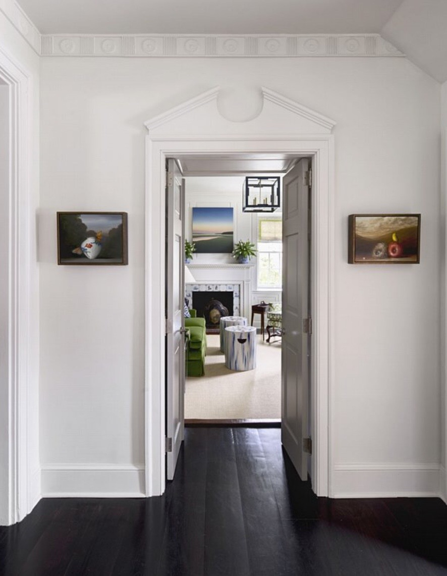 a pair of paintings by david kroll in entry