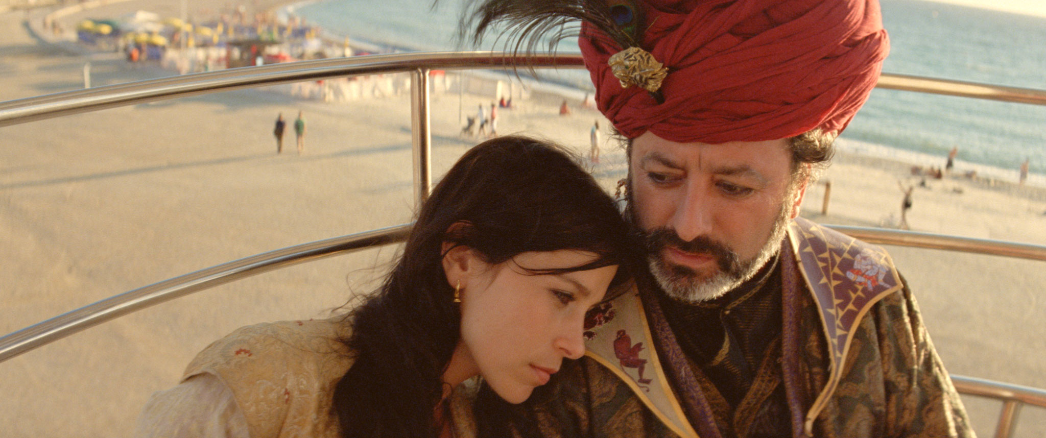 Crista Alfaiate and  Américo Silva ride a Ferris wheel  in   Arabian Nights Volume 3: The Enchanted One  . Image courtesy of the Glasgow Film Festival.