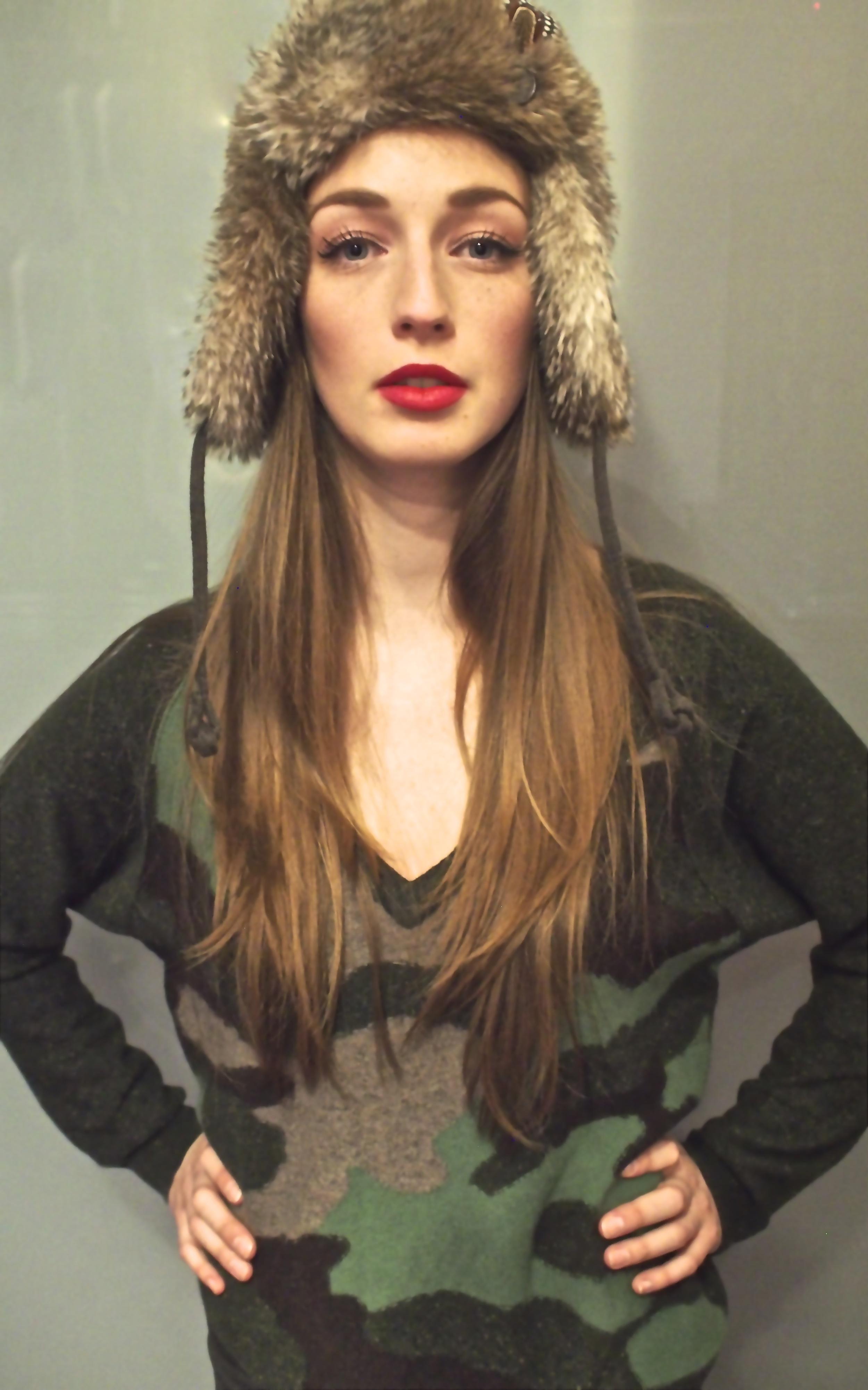 Nobis-Faux Fur Trapper Hat $75, Autumn Cashmere-Camo V Neck Sweater $375, JBrand Skinny Jean $269