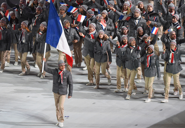 The team from France looked effortless and cool in their gray flannel puffers and chinos designed by Lacoste.