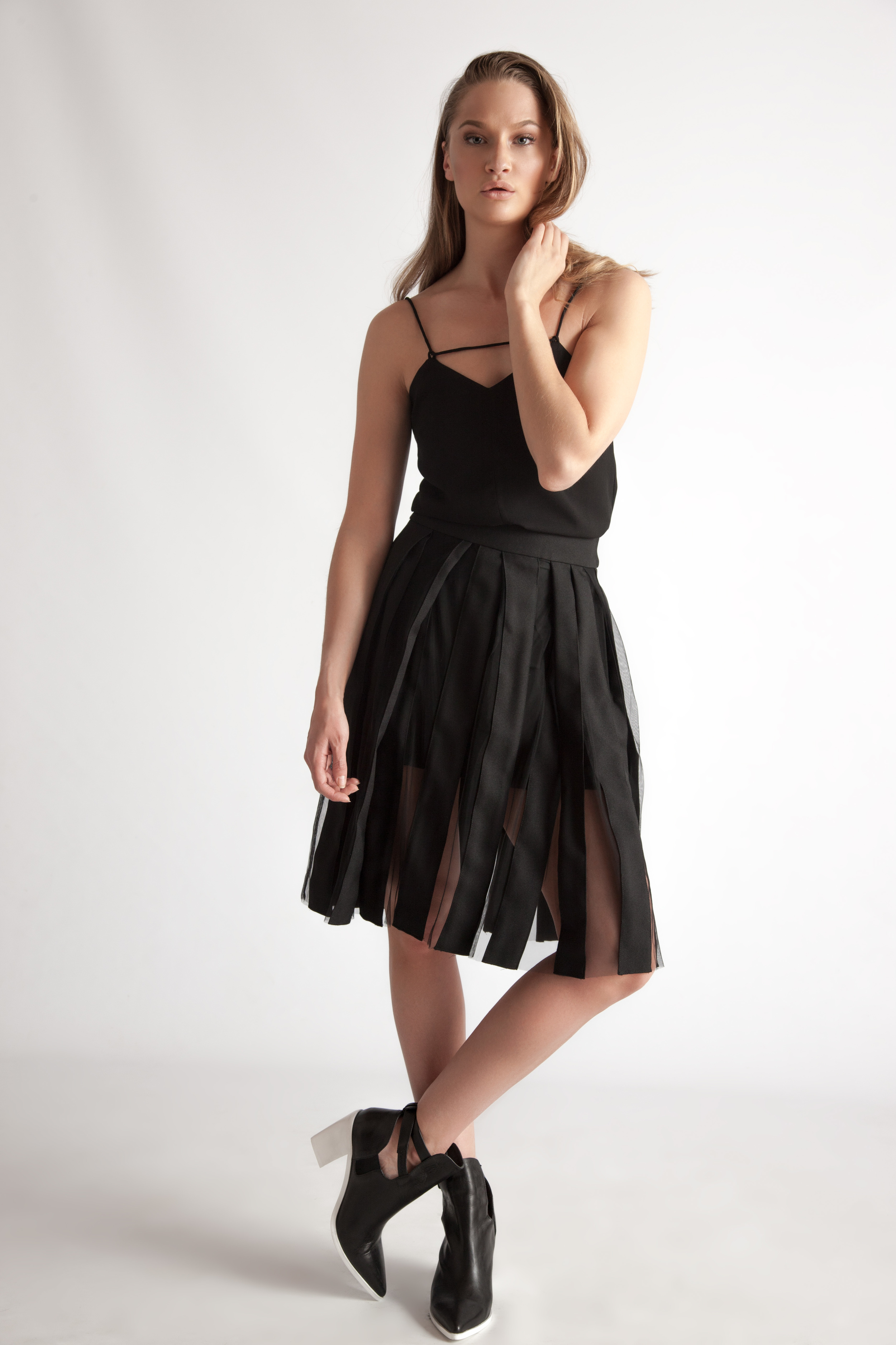 Tank by Finders Keepers $125 | Sheer Panel Skirt by JNBY $225 | Booties by Tiger Of Sweden $359