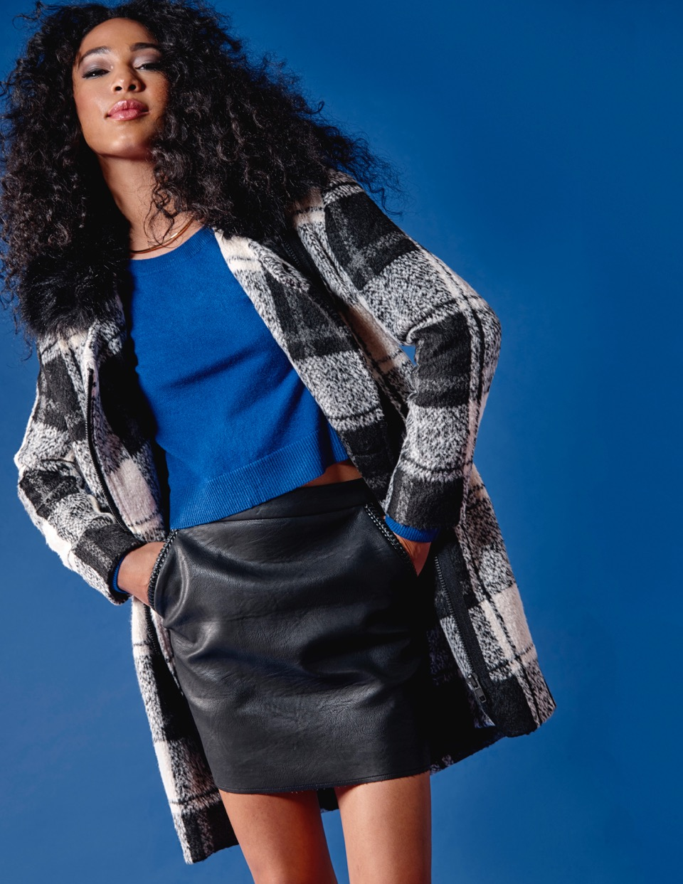 Statement Coats are a must this season, as they are the perfect topper on your already perfect outfit. Another thing this coat has going for it - the removable fur collar.  John & Jenn Plaid Coat $349 Autumn Cashmere Sweater $330 Suncoo Leather Mini Skirt $180