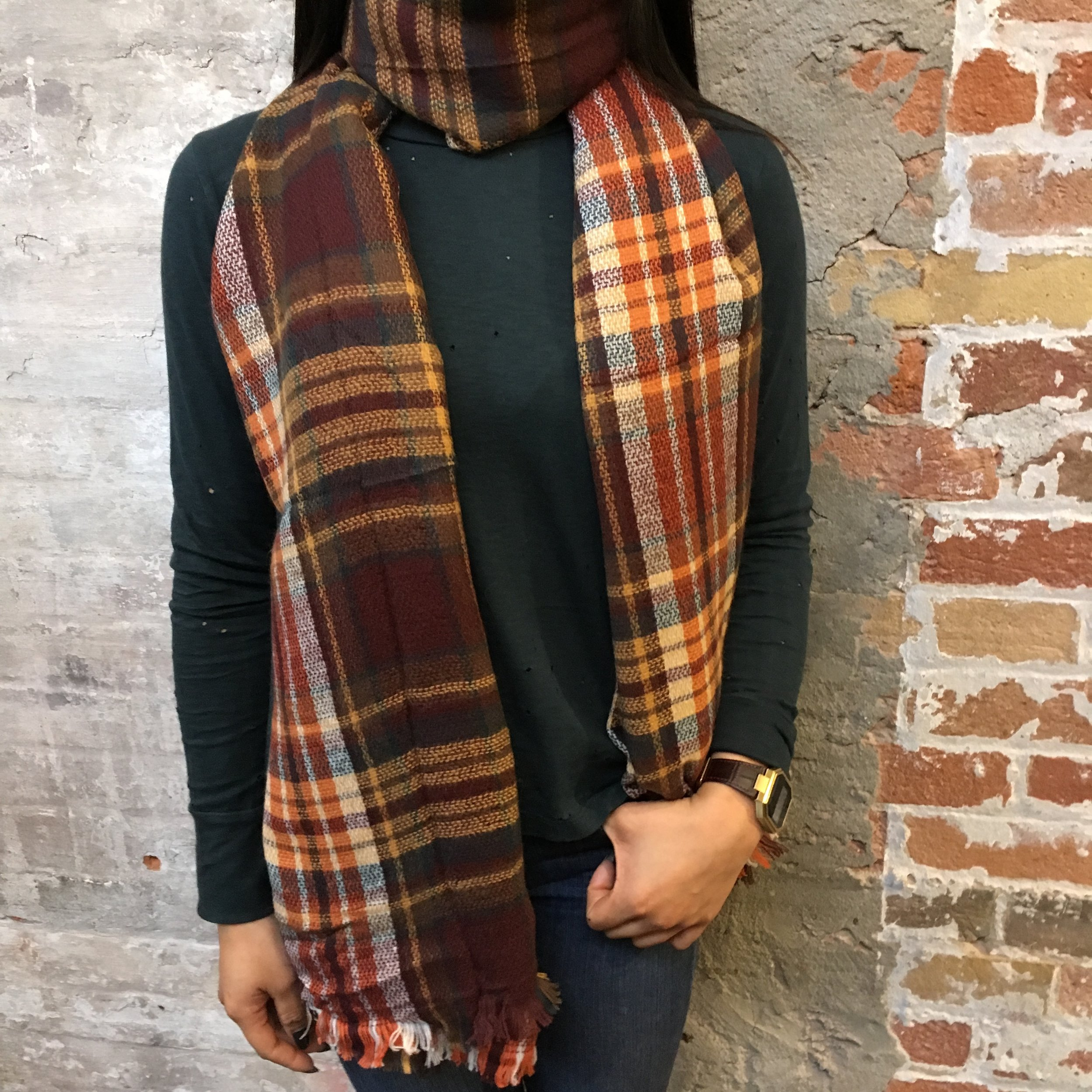 The Go To: Just wrap your scarf around and let the two ends drape in front of you. This simple yet elegant look can be adjusted for however loose or tight you want the neck to be. Works well with jackets but can also be transitioned to an elegant look with a skinnier scarf.