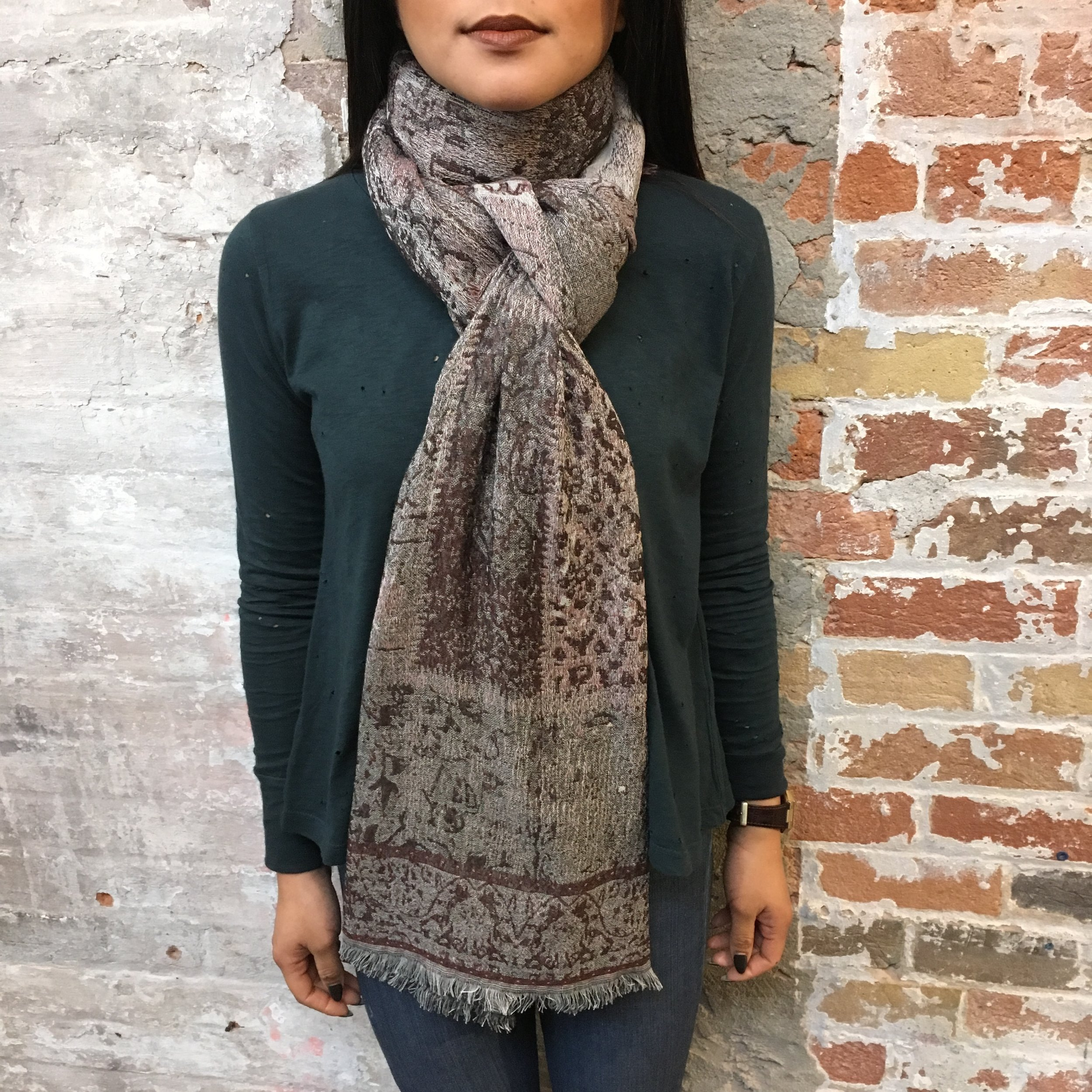 Another version of the one above with a less intricate knot, follow the above steps but only pull one end through the loop, leaving a more relaxed feel to the scarf.