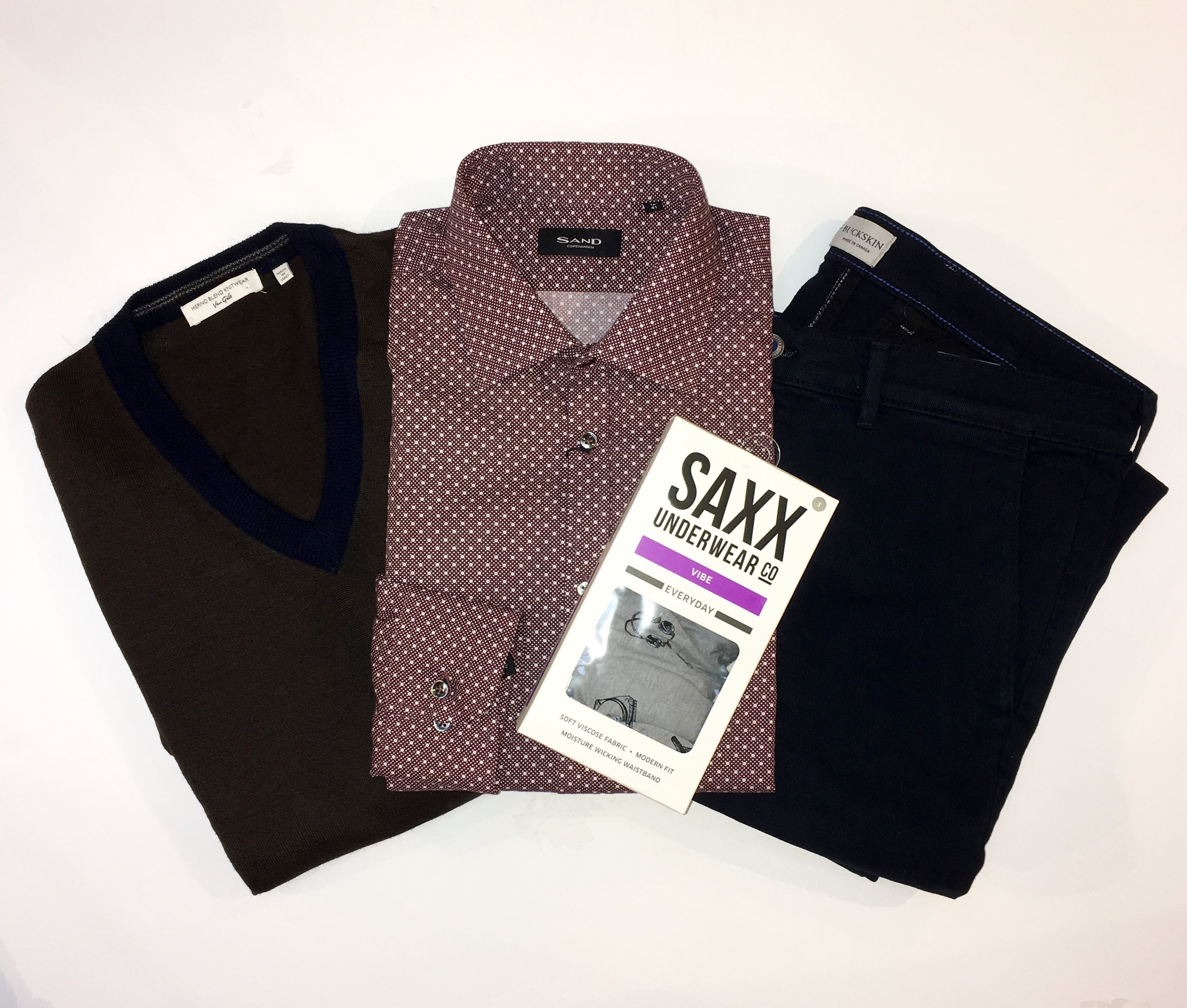 Business Man Starter Pack:  Van Gils Merino Wool Sweater $145 Sand Dress Shirt $225 Buckson Slacks $220 Saxx Underwear $32  - If he  still  hasn't tried these, this is your number one gift idea.