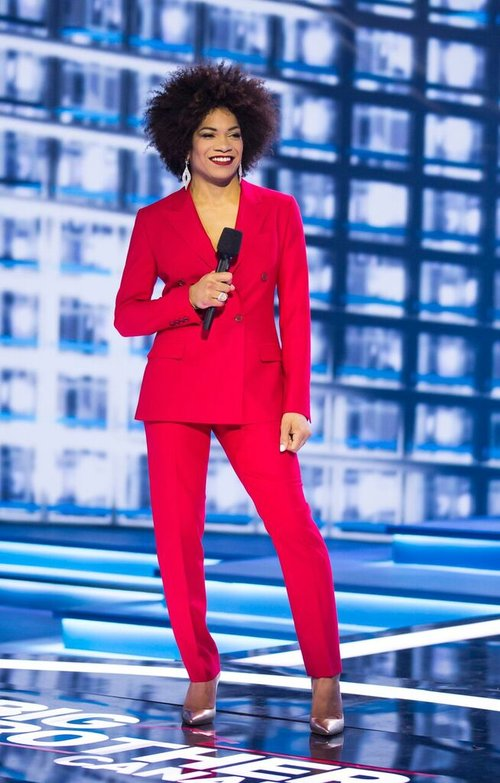 Arisa Cox in two of her custom made suits for the hit show Big Brother