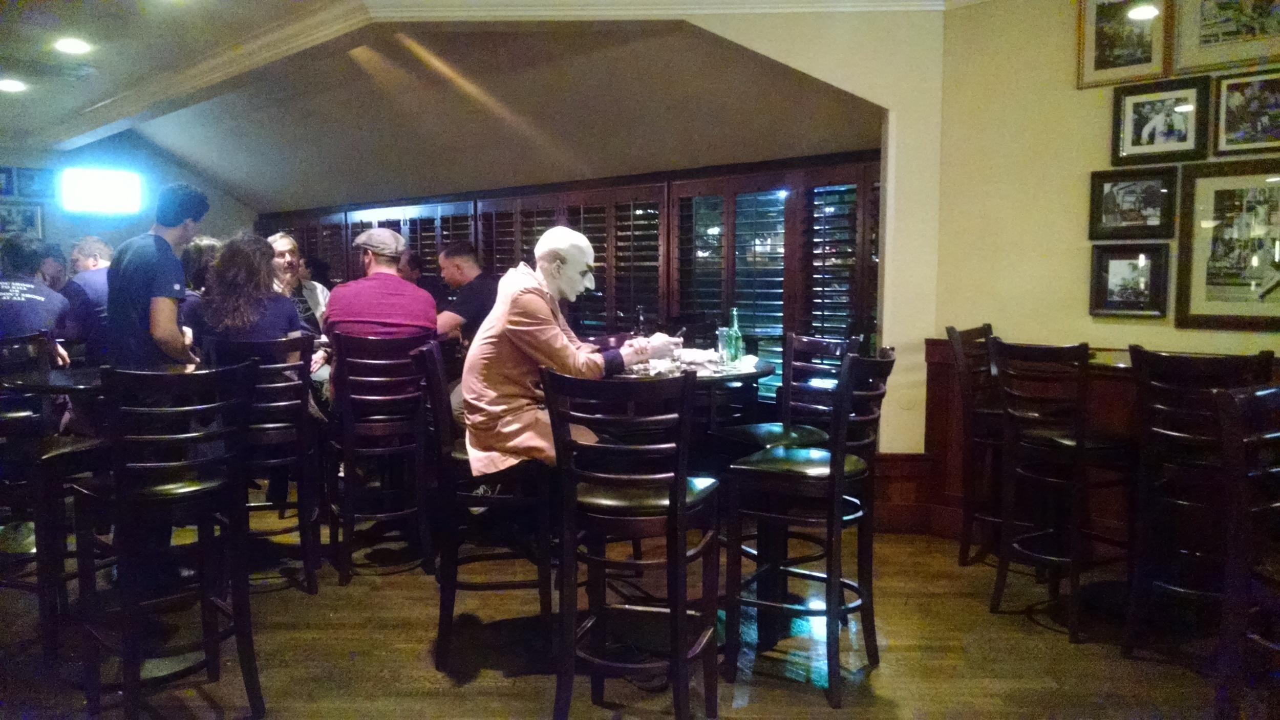 Nosferatu sits alone at the bar