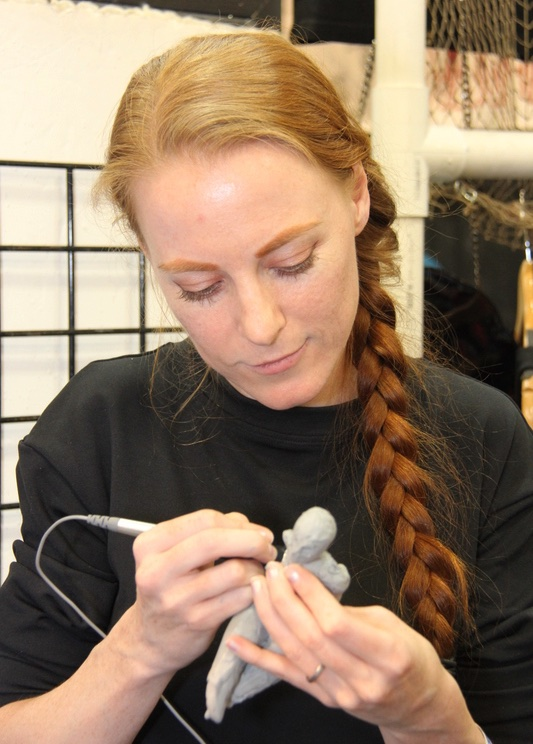 Jessica Dru works on a piece in Cx5s