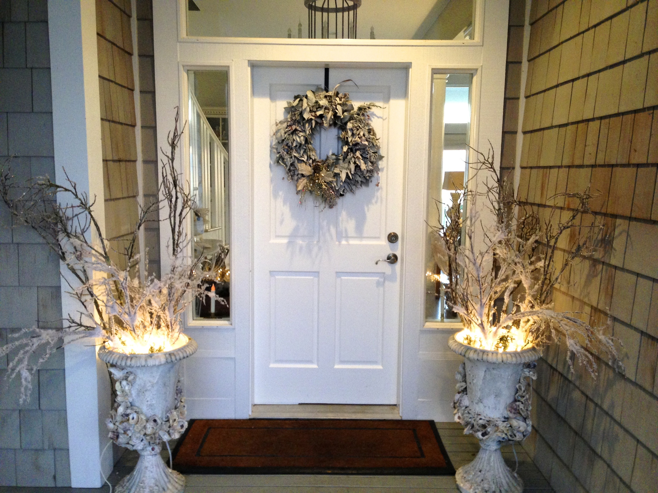 Go elegant or casual with a silver and white theme. White lights illuminate branches in the garden urns.