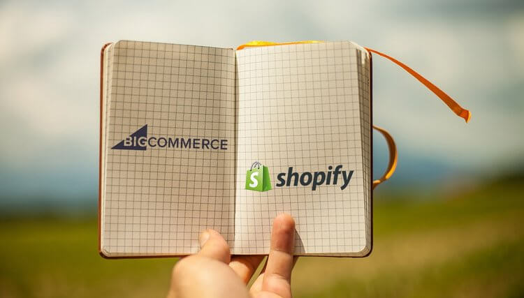 Bigcommerce vs Shopify (image of the two logos in a notebook)