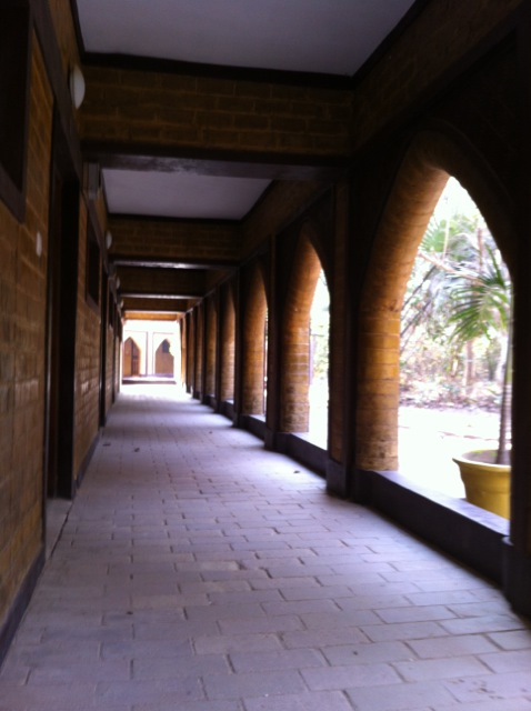 Cloister inspired walkway outside guest rooms