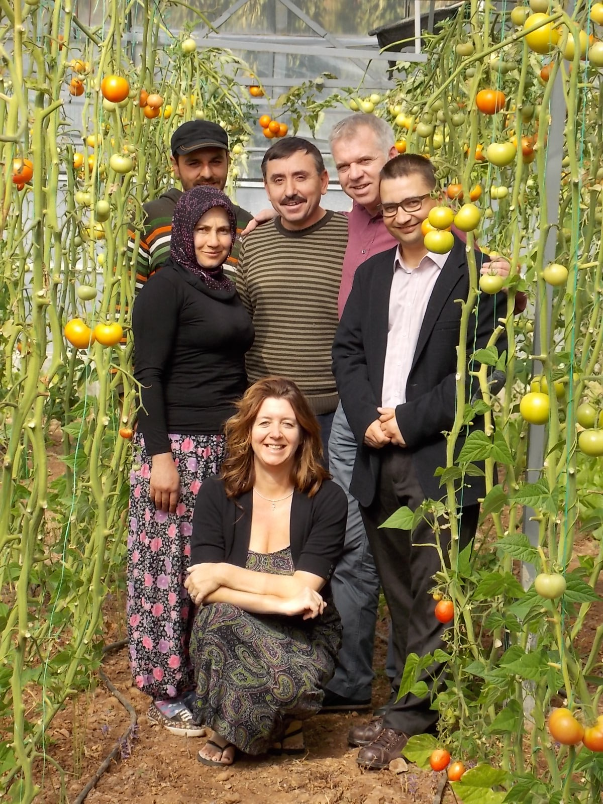 "Jo and colleagues with a tomato farmer and his wife in Arpacik in Turkey. They grow tomatoes ""Taste of Fethiye"" programme."