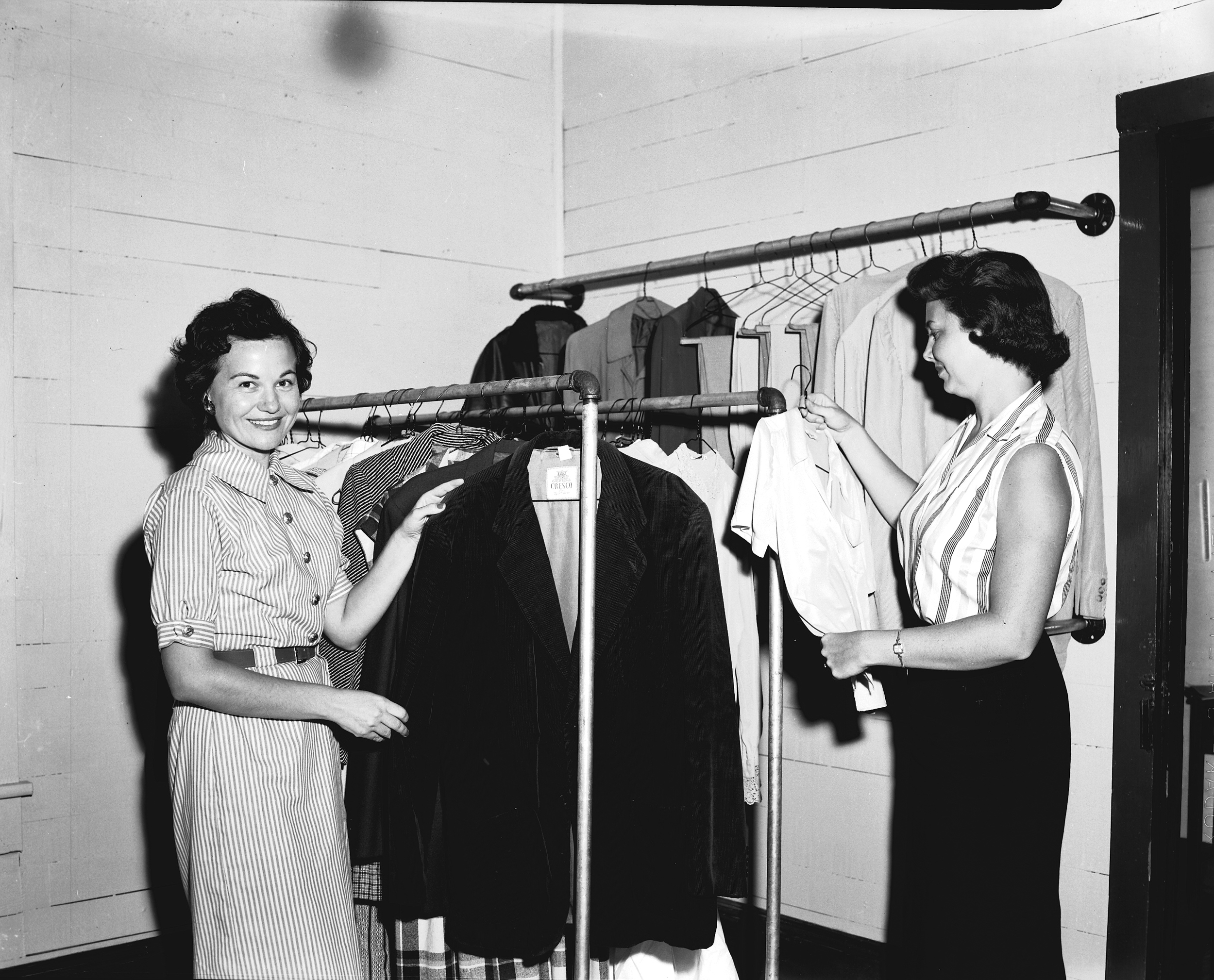 Service League members working at the coat closet in downtown Canton, circa 1958.