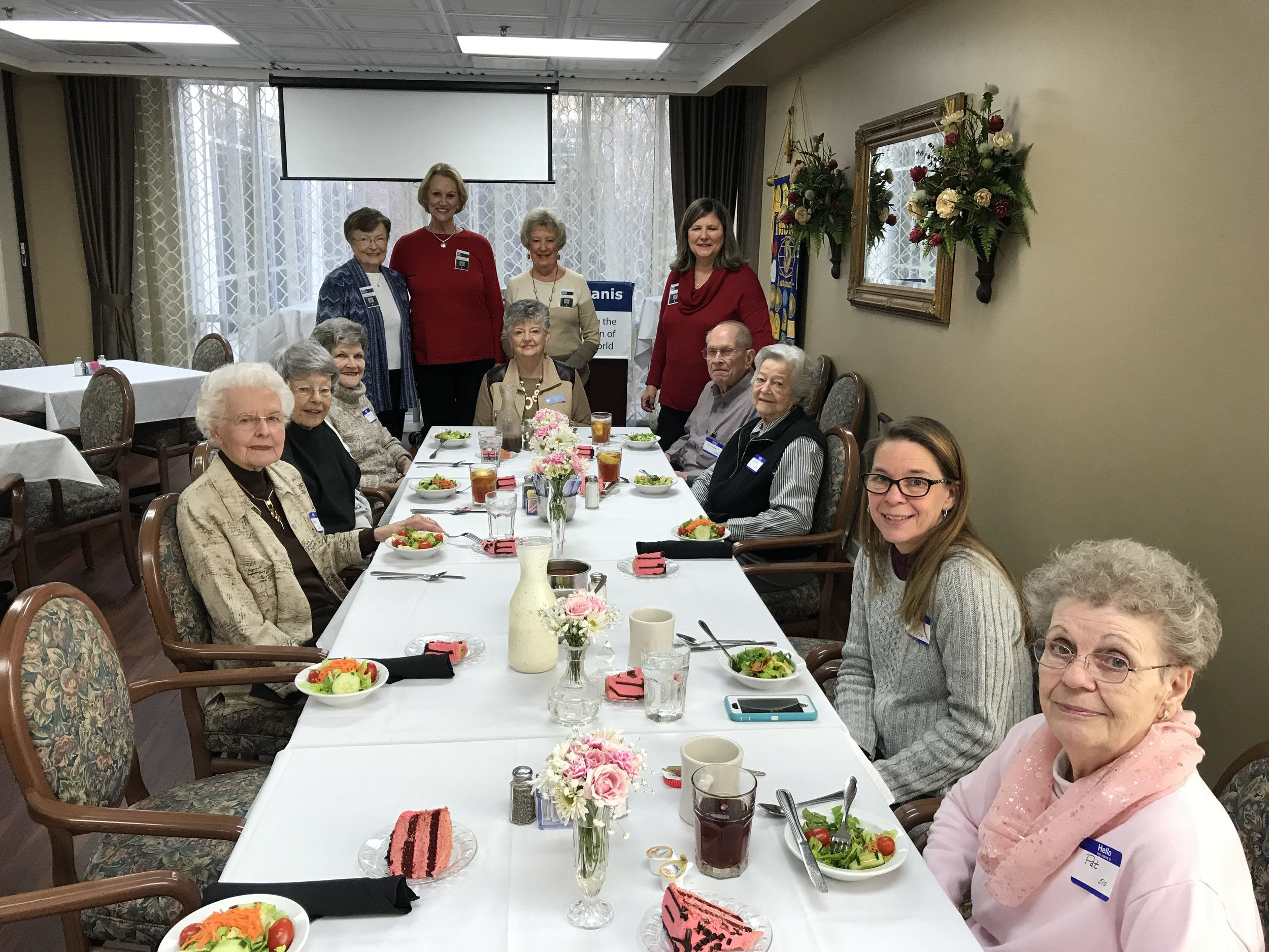 Volunteers working with our Mission in a Mile program, help each month with the Birthday Luncheon for the residents at Talmadge Terrace.