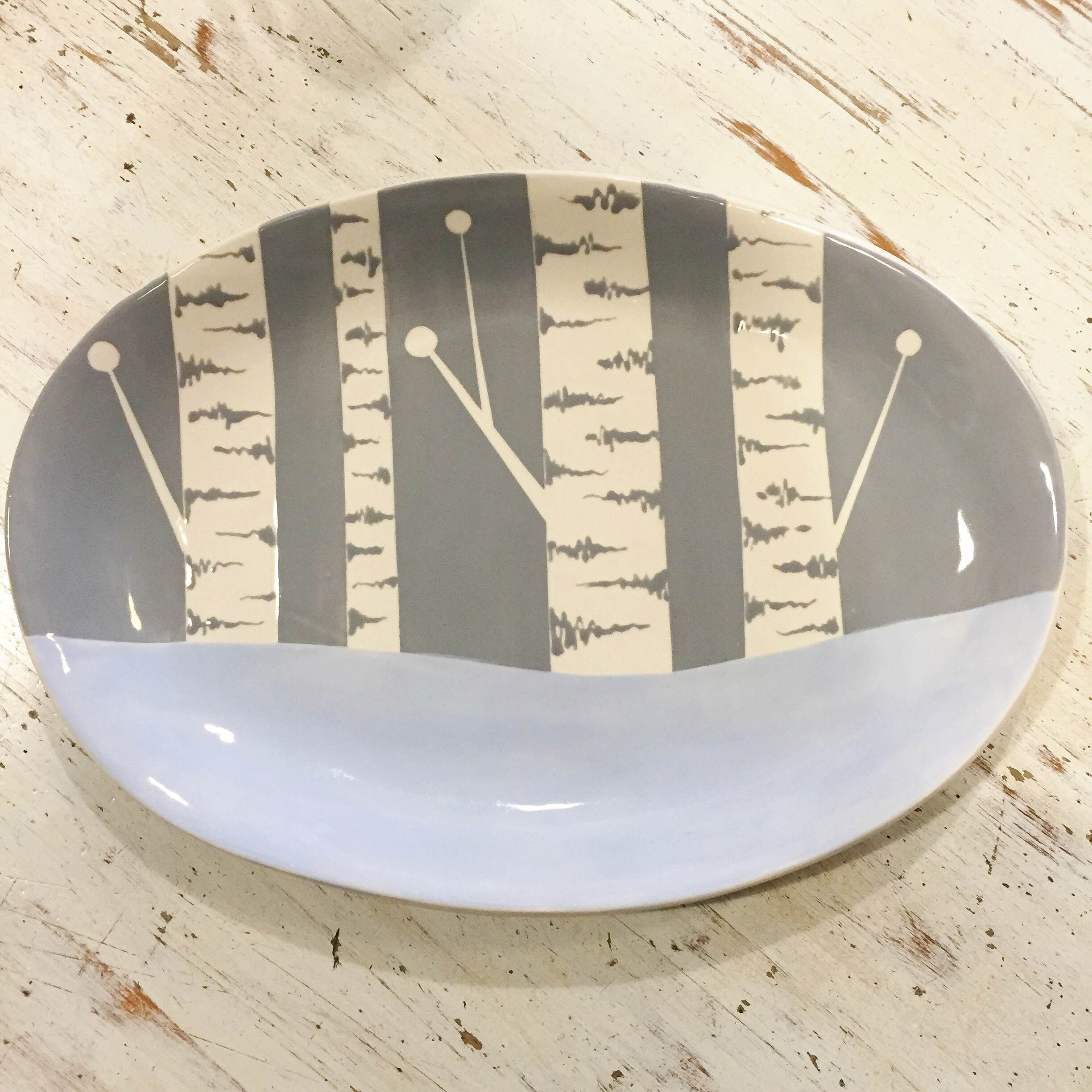 Learn how to paint this beautifully simple birch tree design on any plate you choose with one of our talented artists! Price depends on the size and style of your plate. You can also enjoy a coffee or glass of wine while you paint! Call us to reserve your spot today!