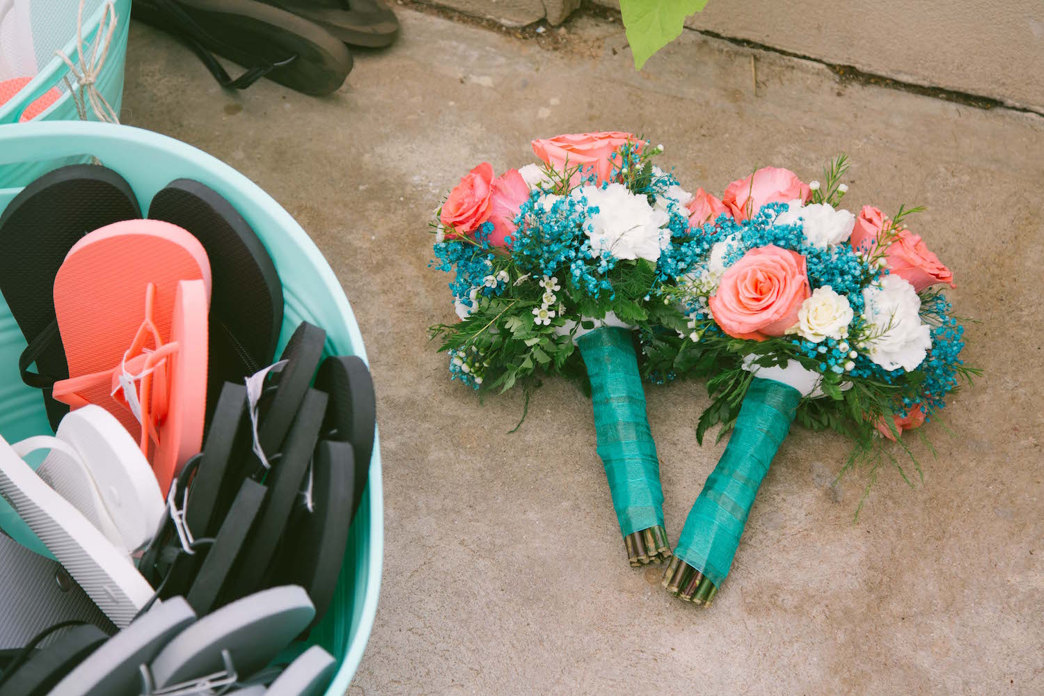 The details of this wedding were unbelievable. The bridesmaid bouquets even matched the sandal buckets!