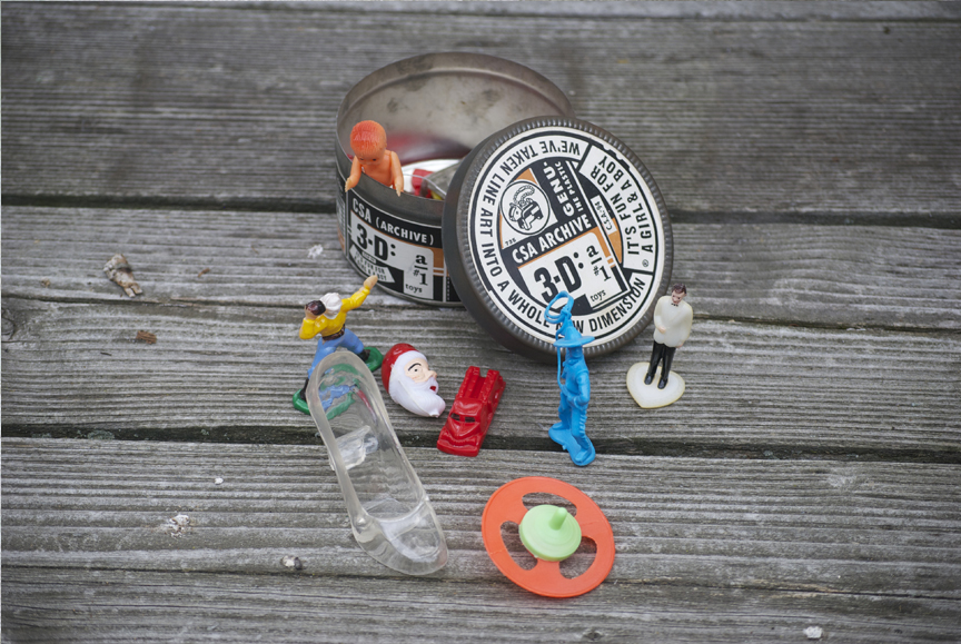 Mid 1990's promo tin full of plastic playthings.
