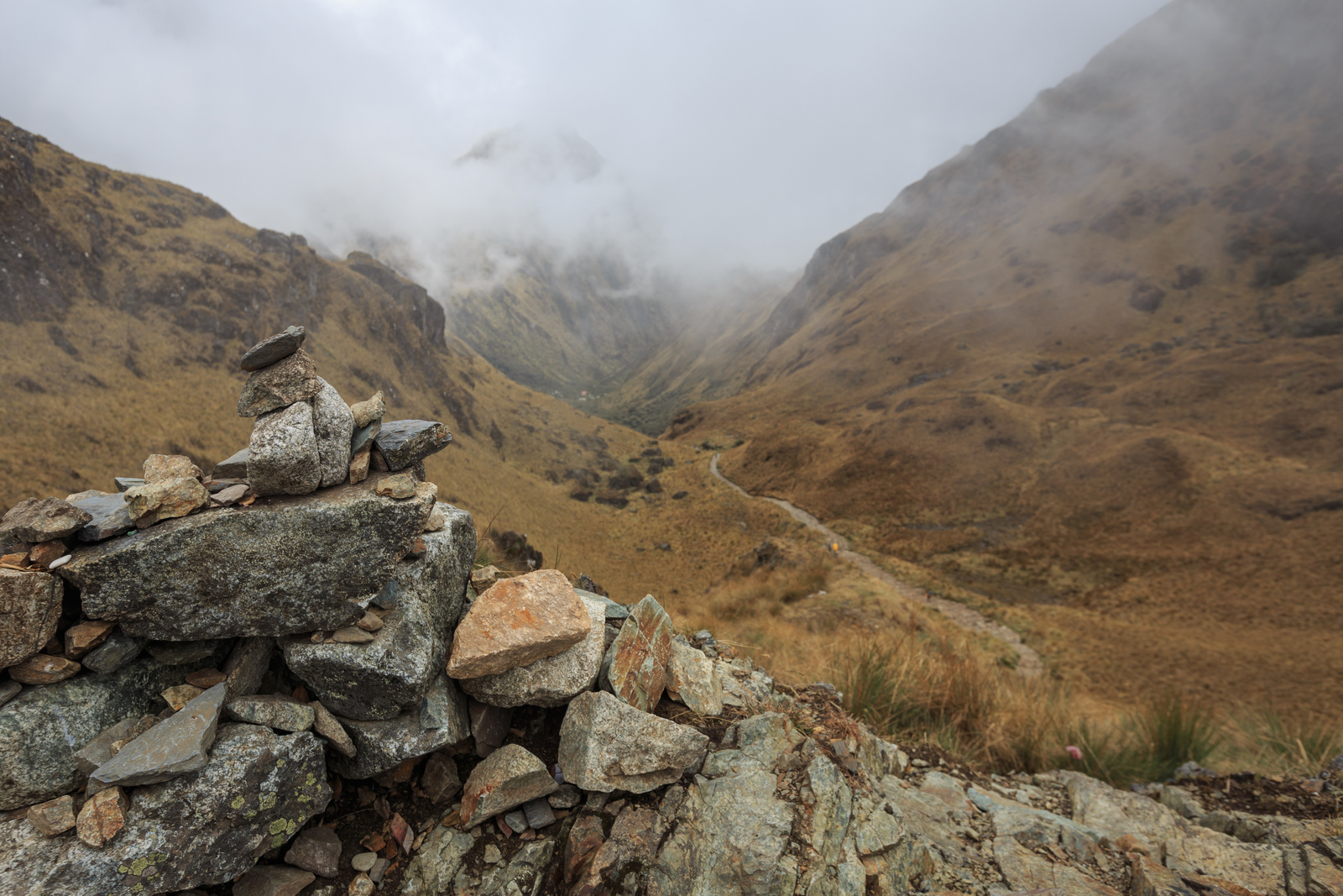 Rock cairn and the view down the other side