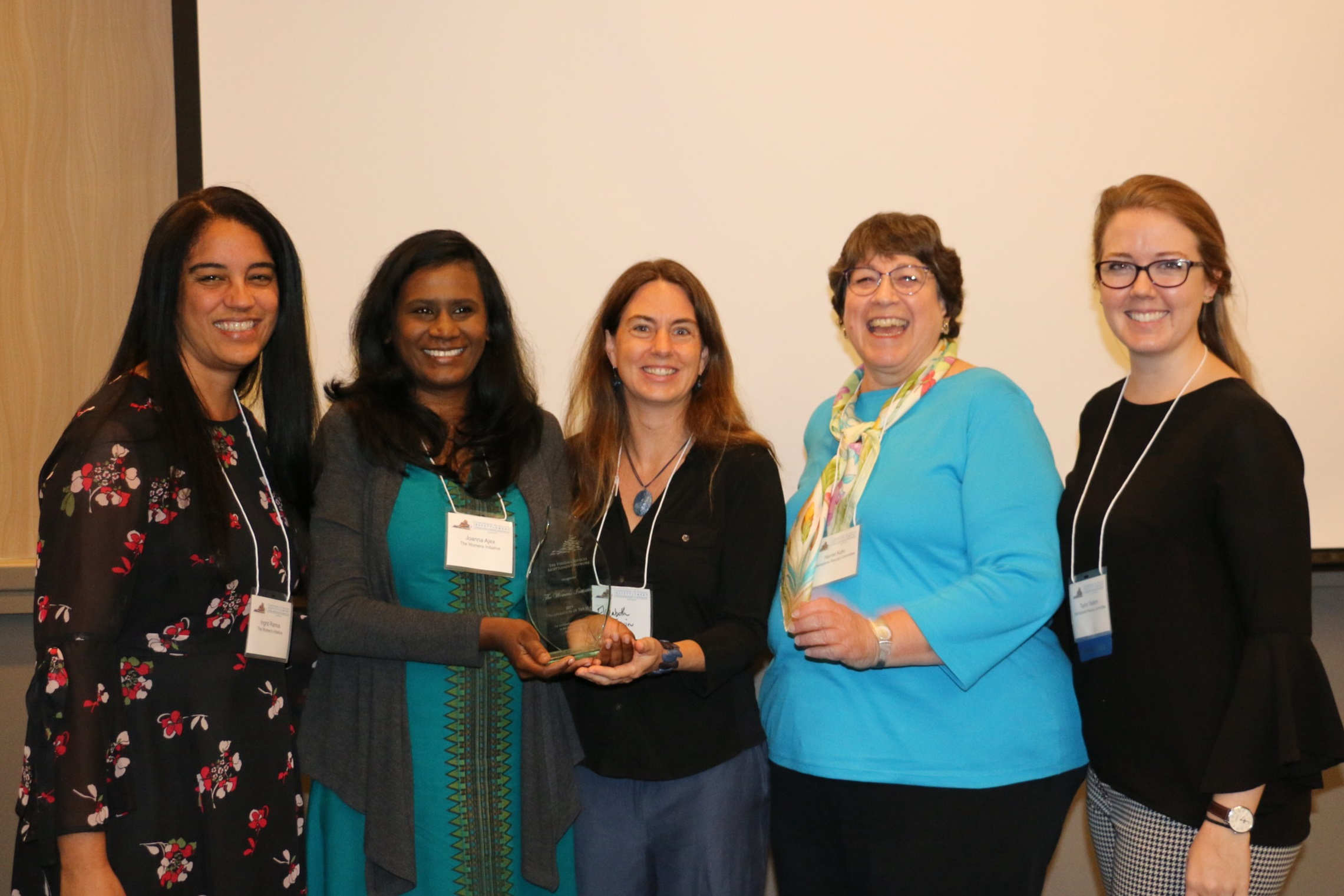 Staff of The Women's Initiative and the International Rescue Committee at the award ceremony in July. The IRC cited the impact of the work of TWI therapist Joanna Ajex, MA, second from left, who provides counseling to refugees at the IRC office in Charlottesville each week.