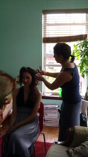 Lisa DeMaria of Salon Topaz works the models hair.