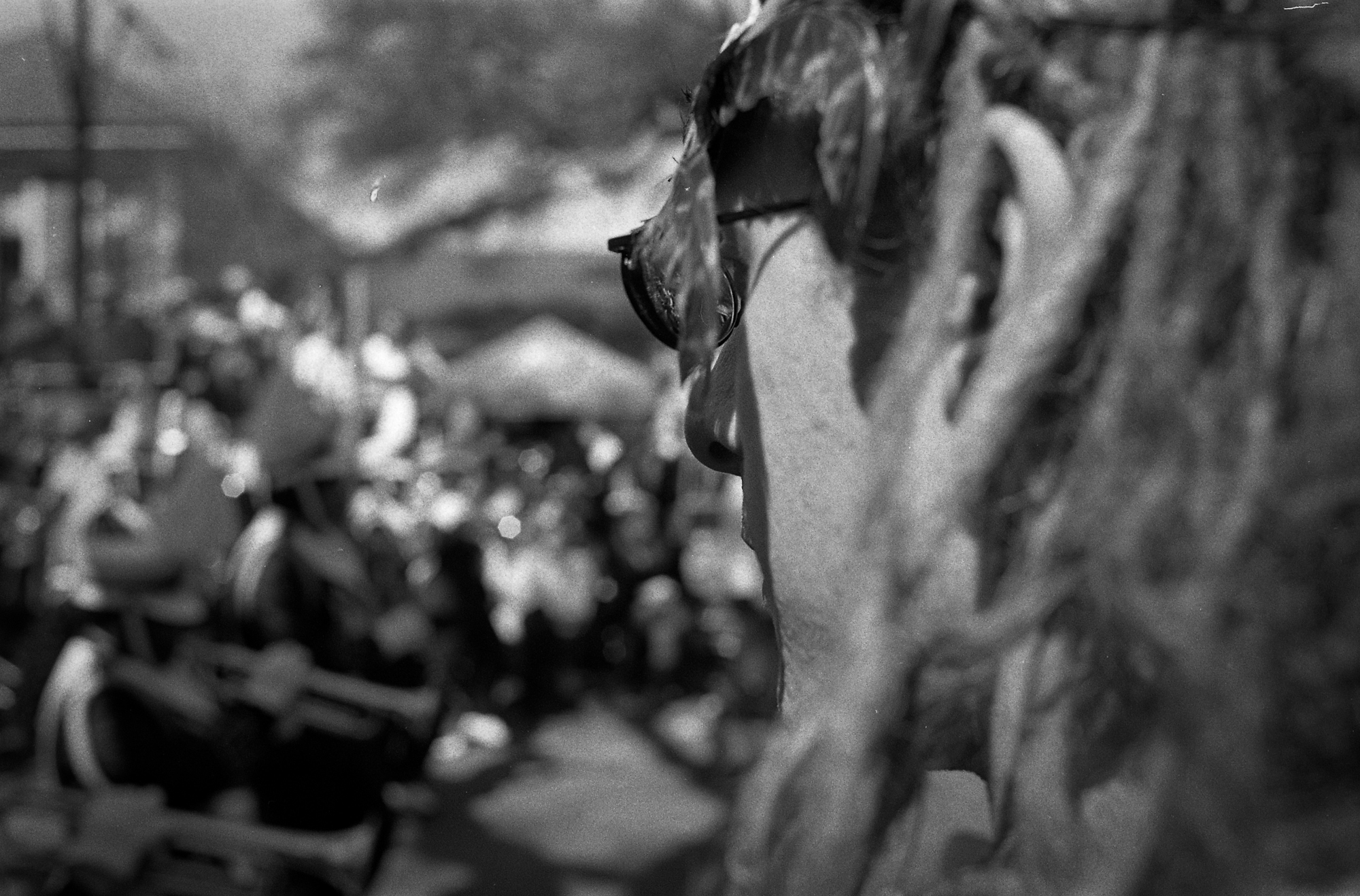 Parade watcher.     New Orleans, LA.  2010  35 mm B&W film.