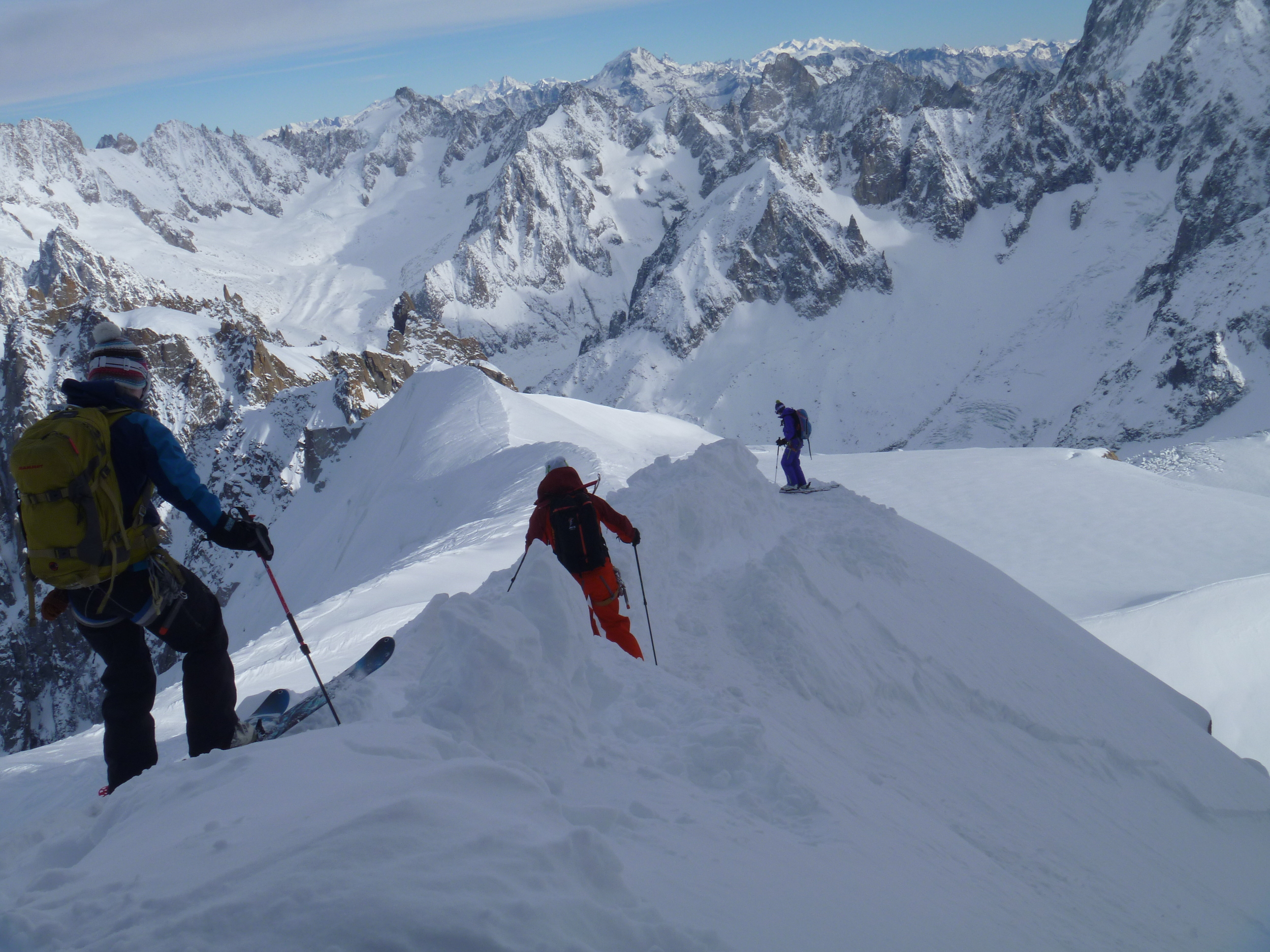 (From left to right) Erin, Miles, and Liz Smart skiing the pre-equipped arête off the Aiguille du Midi in December.