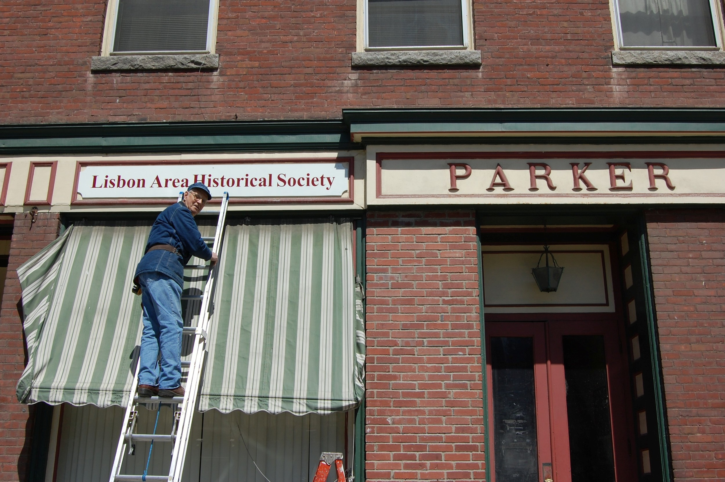 Installing our new museum sign