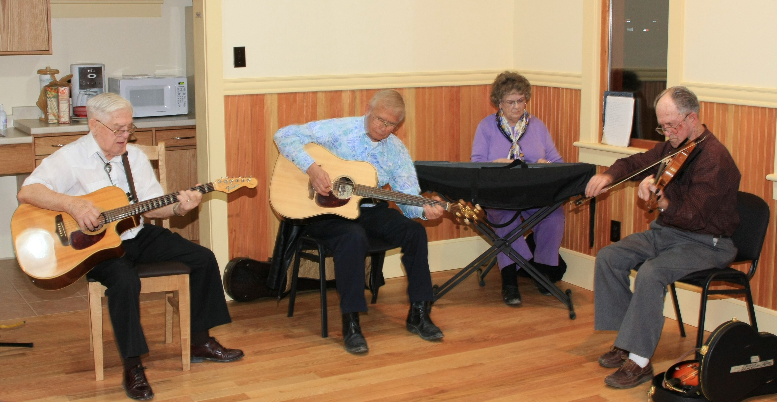 John MacIver, old -time fiddler (at right) is joined by Shorty Boulet, Gary Young, and Helen Sargent.
