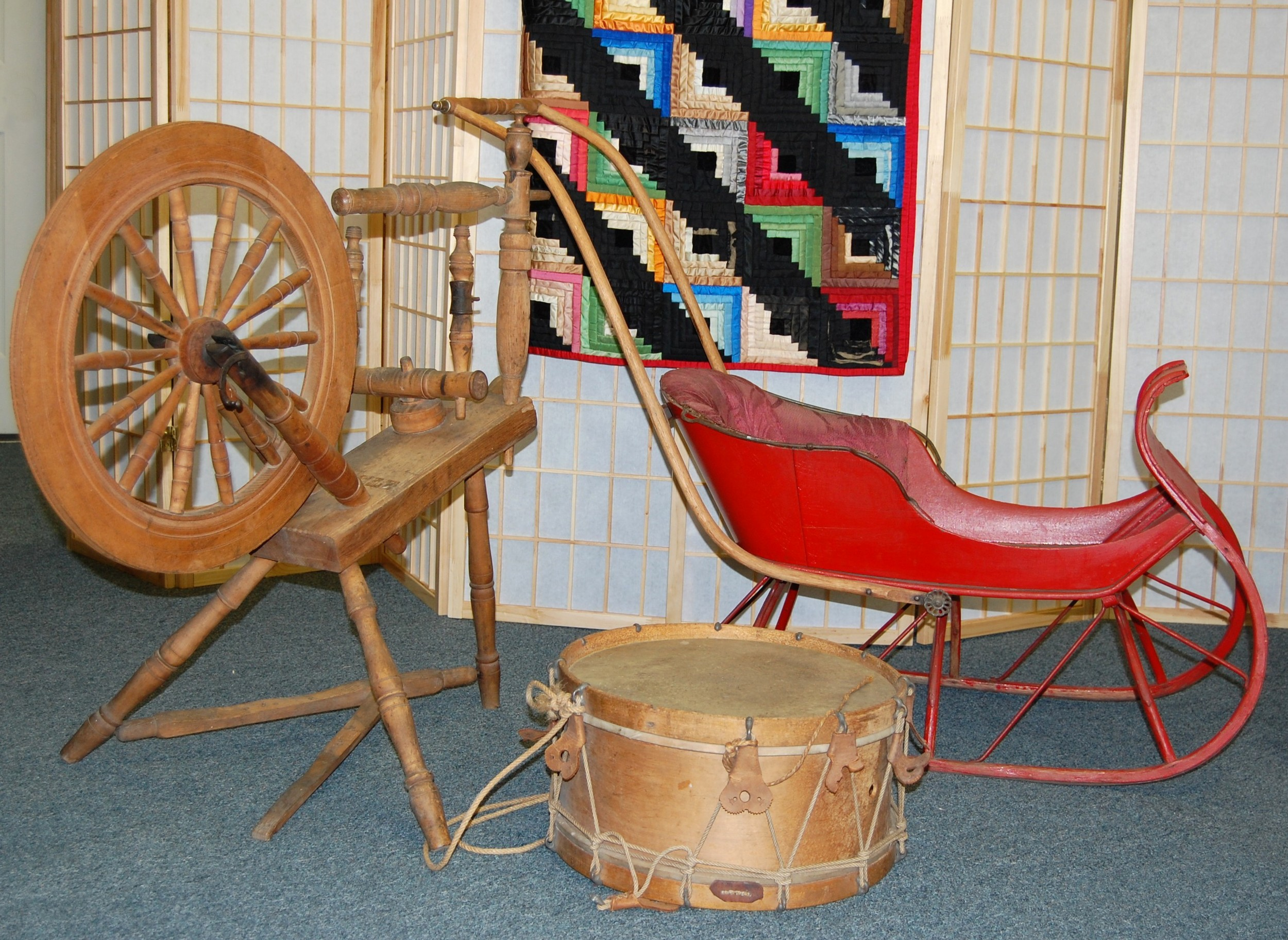 Sleigh, quilt, and drum