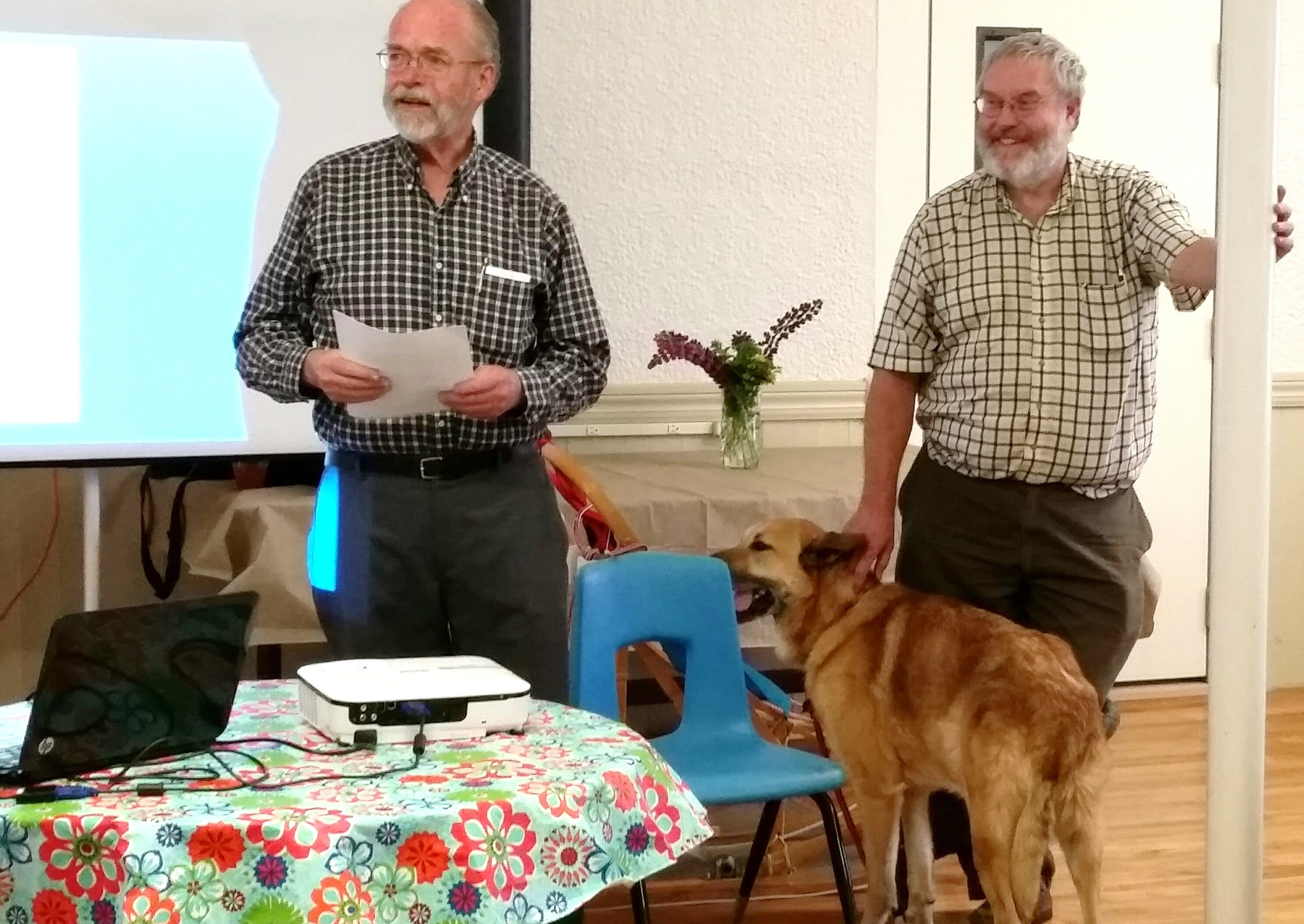 """On June 15, 2016, the Lisbon Area Historical Society was pleased to host a New Hampshire Humanities Council program on the history of dog sledding and the role of New Hampshire's State dog, the Chinook . At left is Cary Clark, LAHS Board of Trustees member introducing presenter Bob Cottrell and his Chinook, """"Tug."""""""