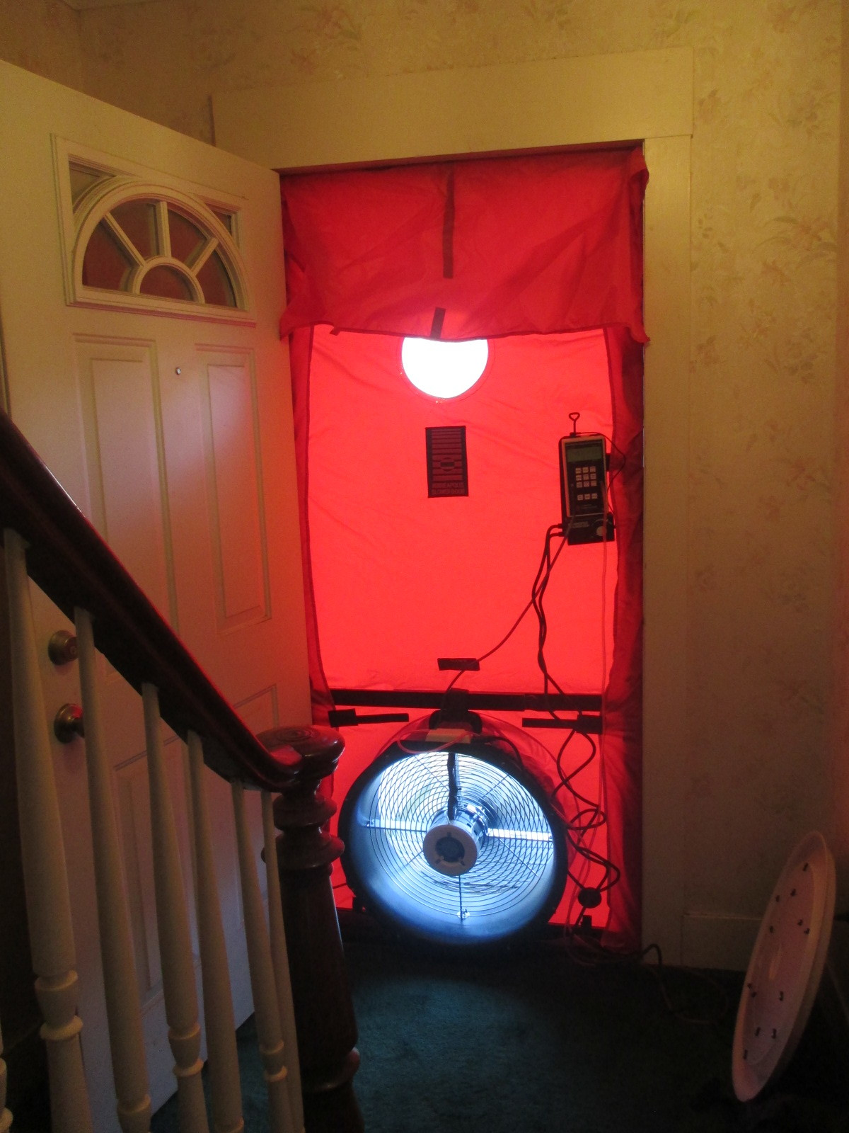 A blower door test measures the rate of air infiltration in the house. It is advantageous to do a blower door test before any work starts. A final test will verify the reduction in air leakage, and the performance based rebate will account for the improvement.