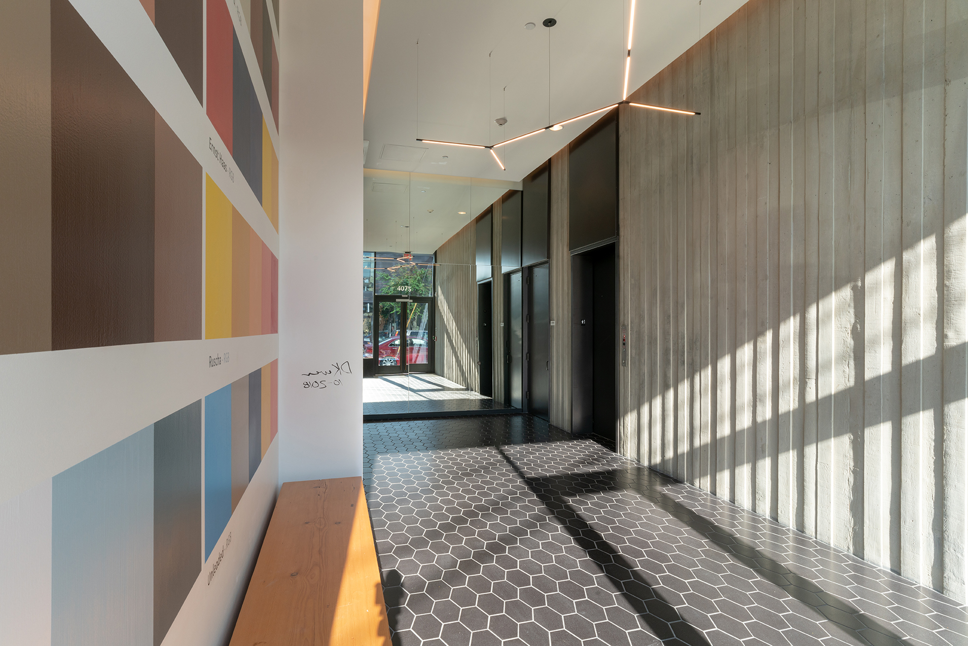 The lobby of the Silica building featuring William / Kaven Architecture partner Daniel Kaven's mural,  Architecture of Normal.