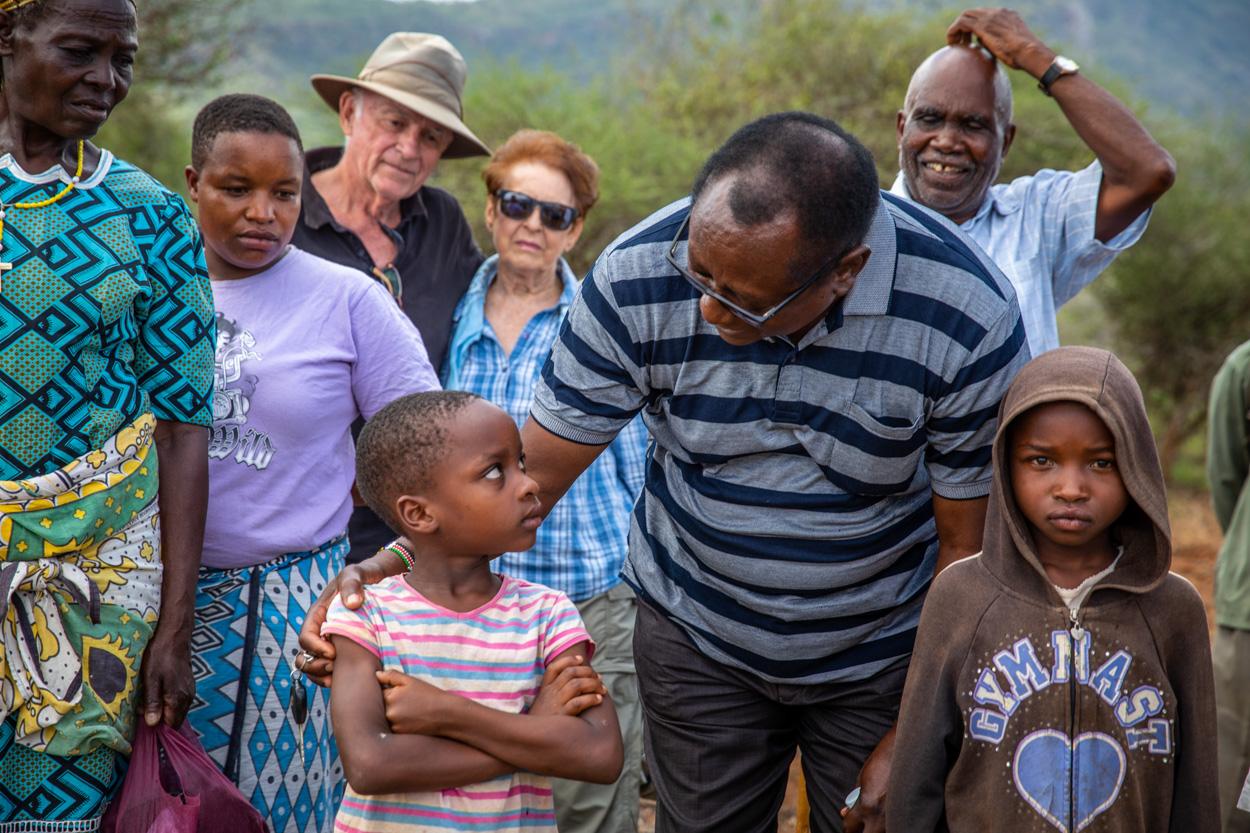 Local catholic priest encouraging the village children