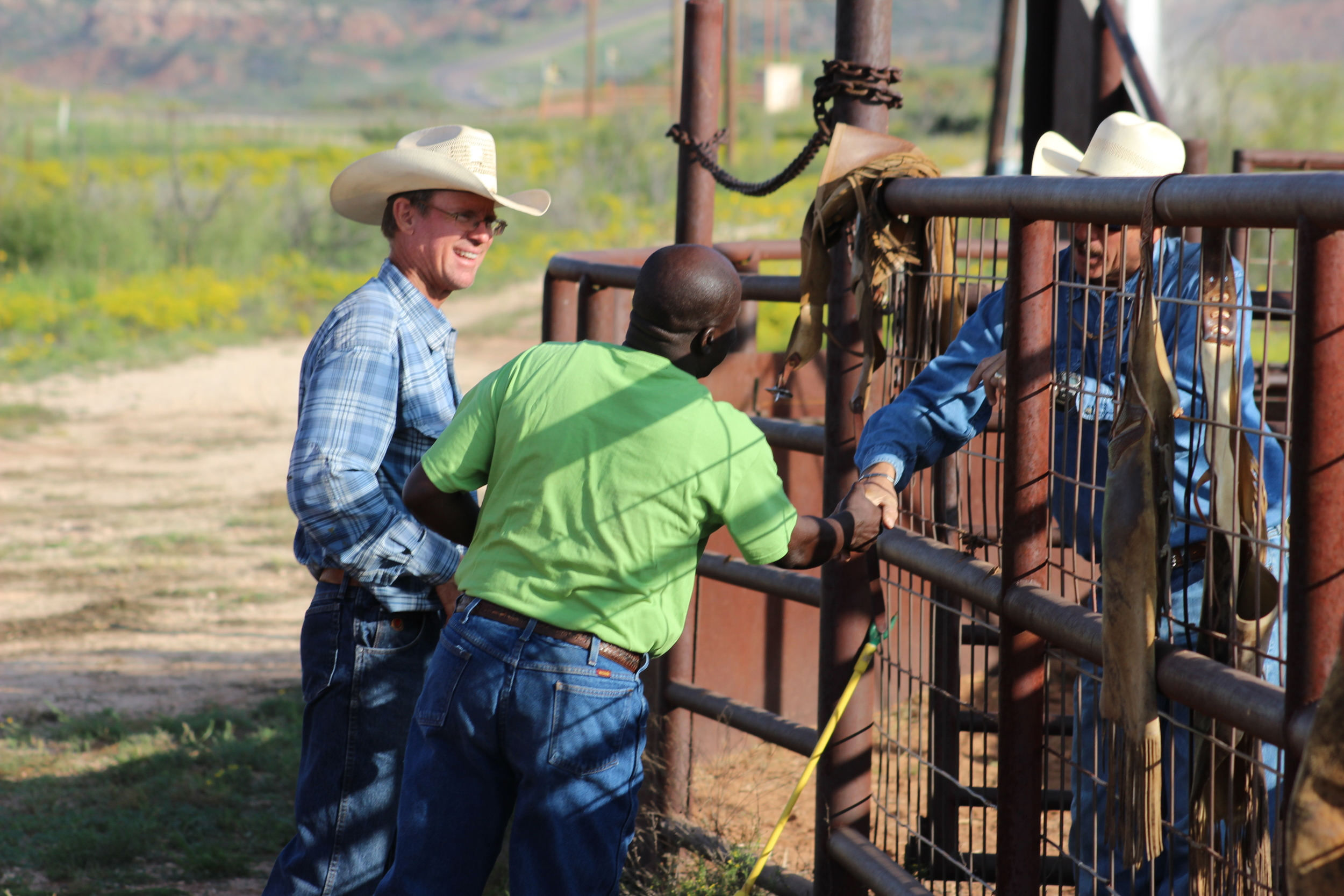 Drew showing Pastor Phiri around his ranch in Post, Texas.