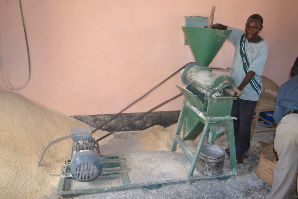 If the family can afford it, they take their corn to the maize mill for grinding. This is the mill at the Grace Center, one of our sustainability projects.