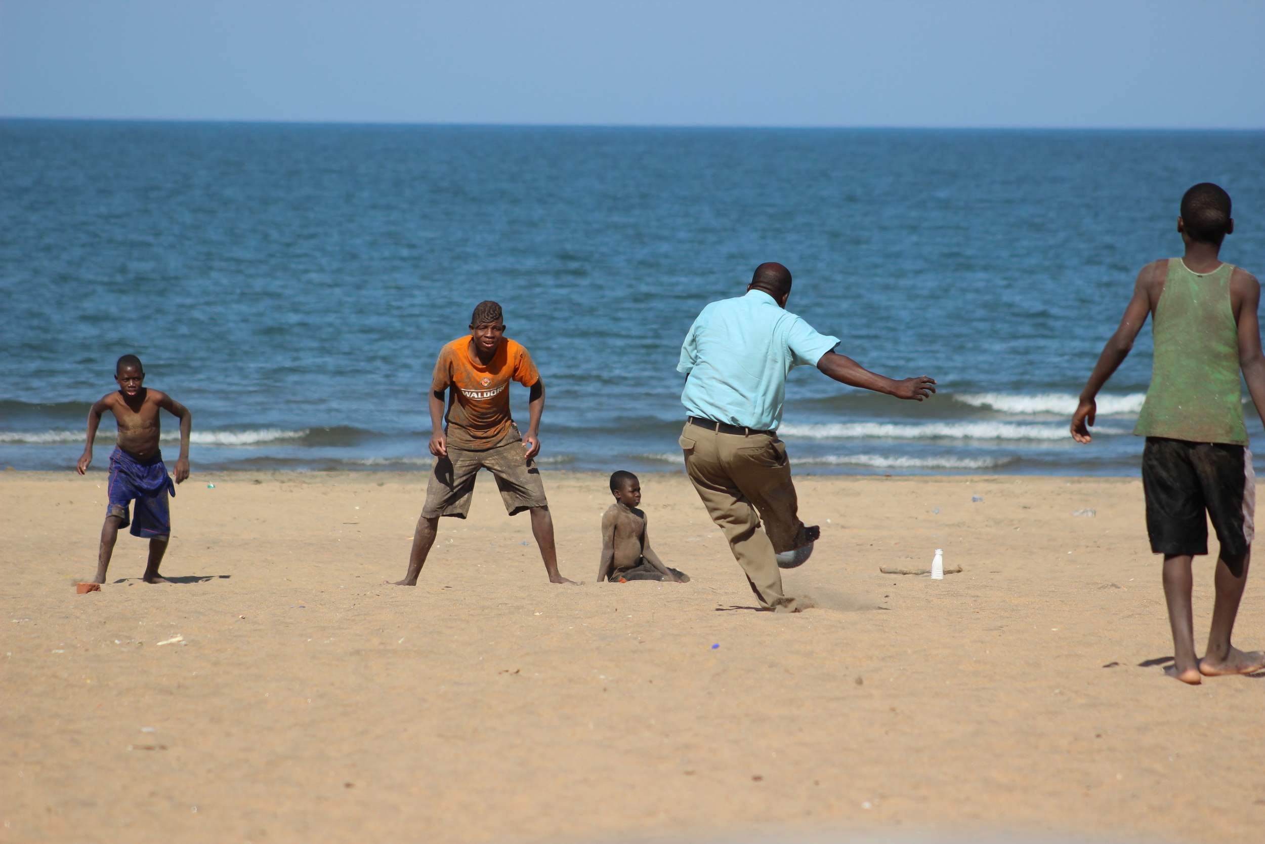Pastor Phiri playing soccer with the boys.