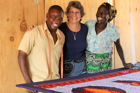 Rotarian, Susan Brints, with Mr. James and Mayi Lumbe hard at work in the textile center.