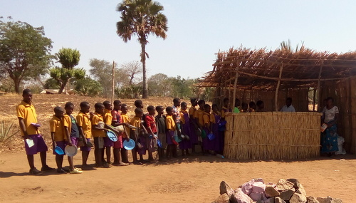 Primary School class lining up for lunch at the temporary kitchen.